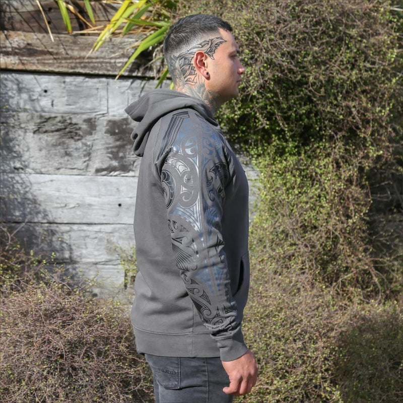 Black unisex hoodie with black and grey ta moko new zealand maori sleeve design. Side view