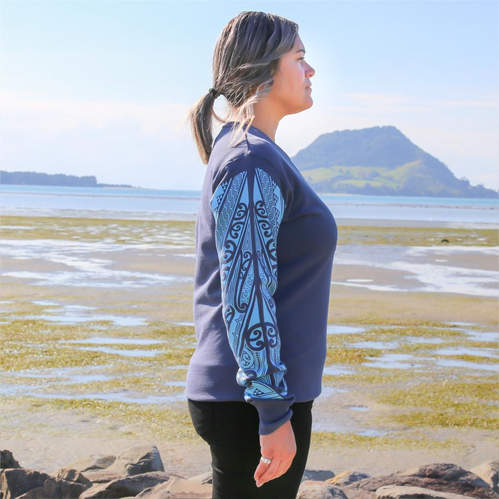 Blue womens crew jersey with maori ta moko sleeve - side