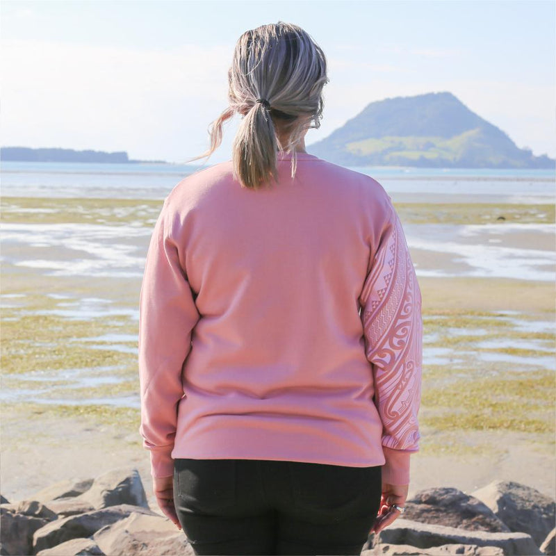 Pink womens crew jersey with maori ta moko sleeve - back