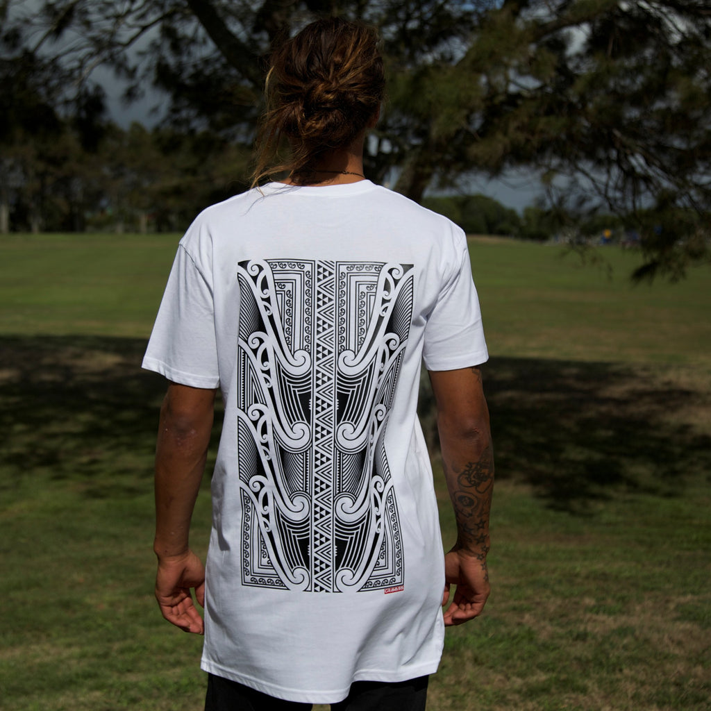 Cravass White tall tee with a black original Maori design on the back.