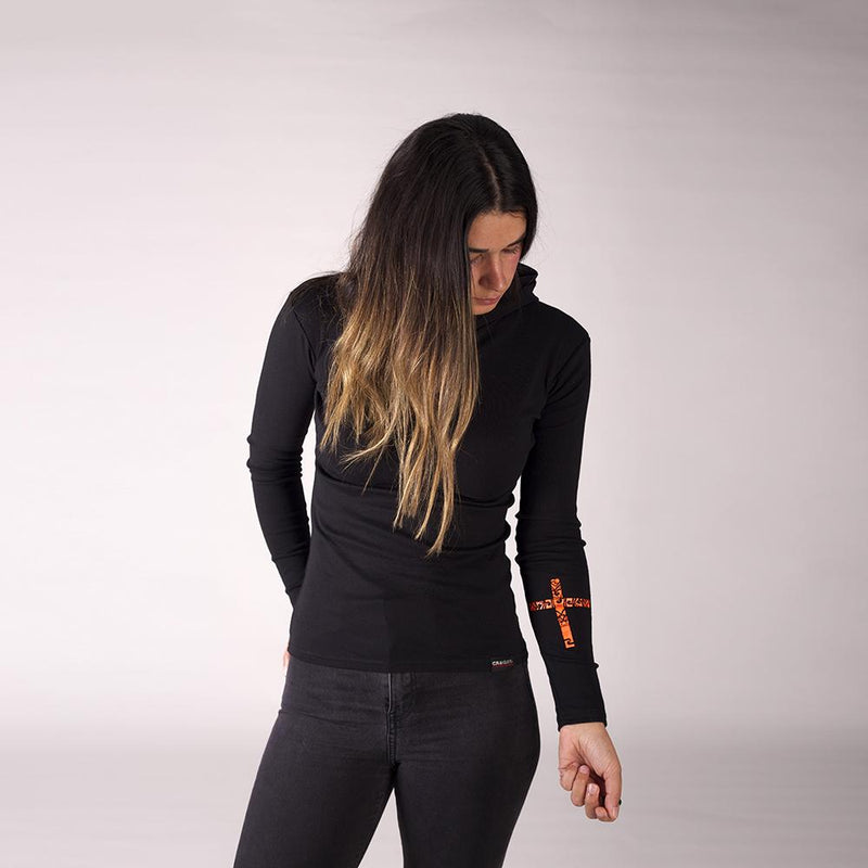 Beautiful female model wearing a black Cravass light hood with a maori inspired cross design on the forearm.