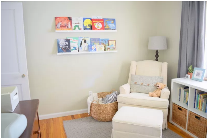 A comfortable reading nook in a simple and serene nursery