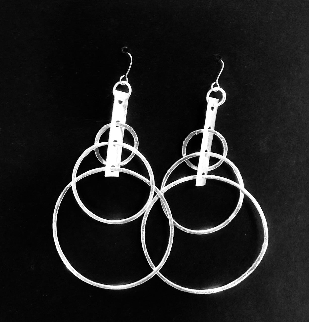 Circles and stem silver earrings