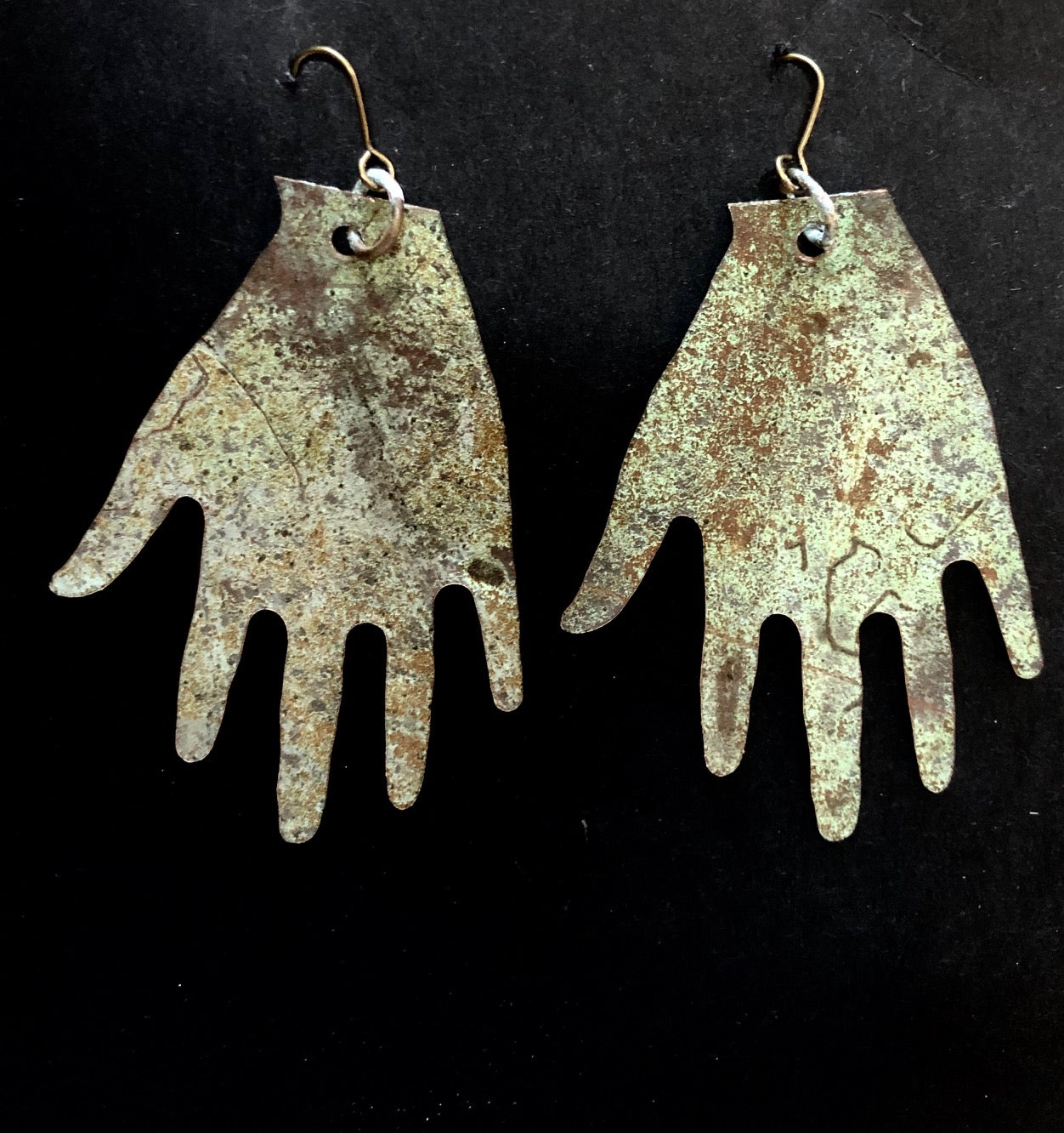 Church roof hands big earrings