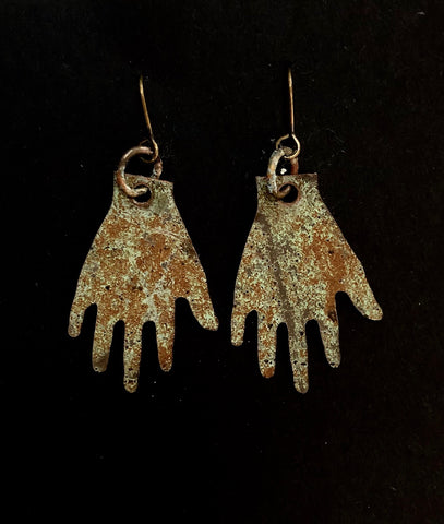 Church hands small earrings