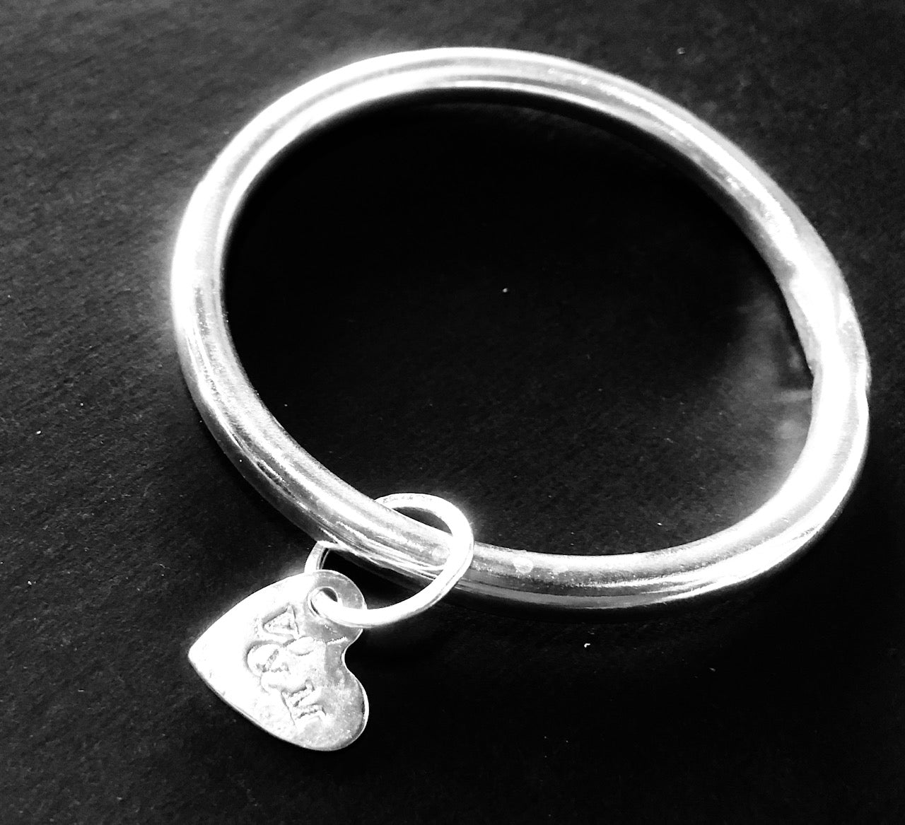 Classic silver bangle with heart