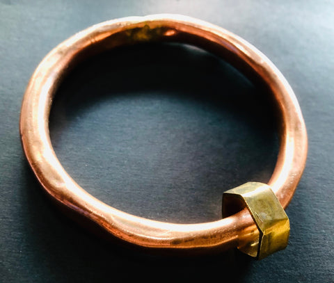 Copper anvil bangle with brass shape