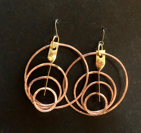 Copper hoops and stem feature earrings
