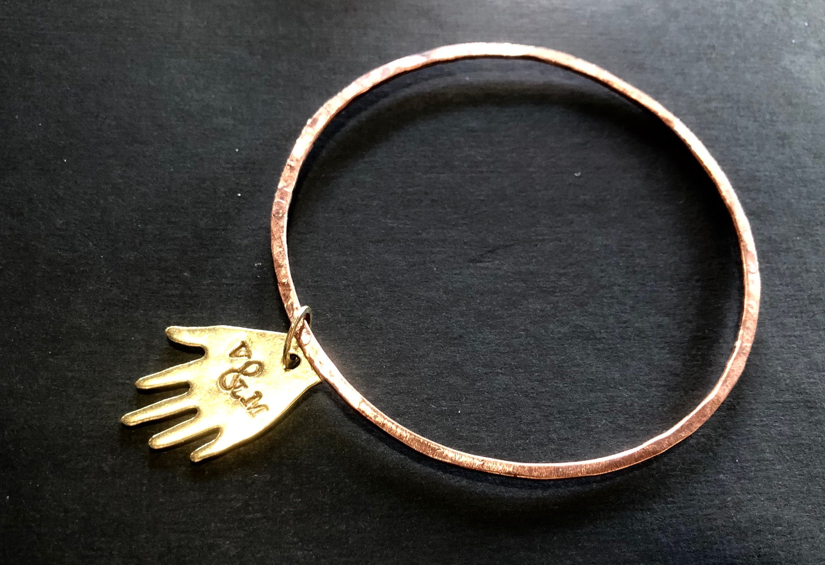 Thin copper bangle with brass hand