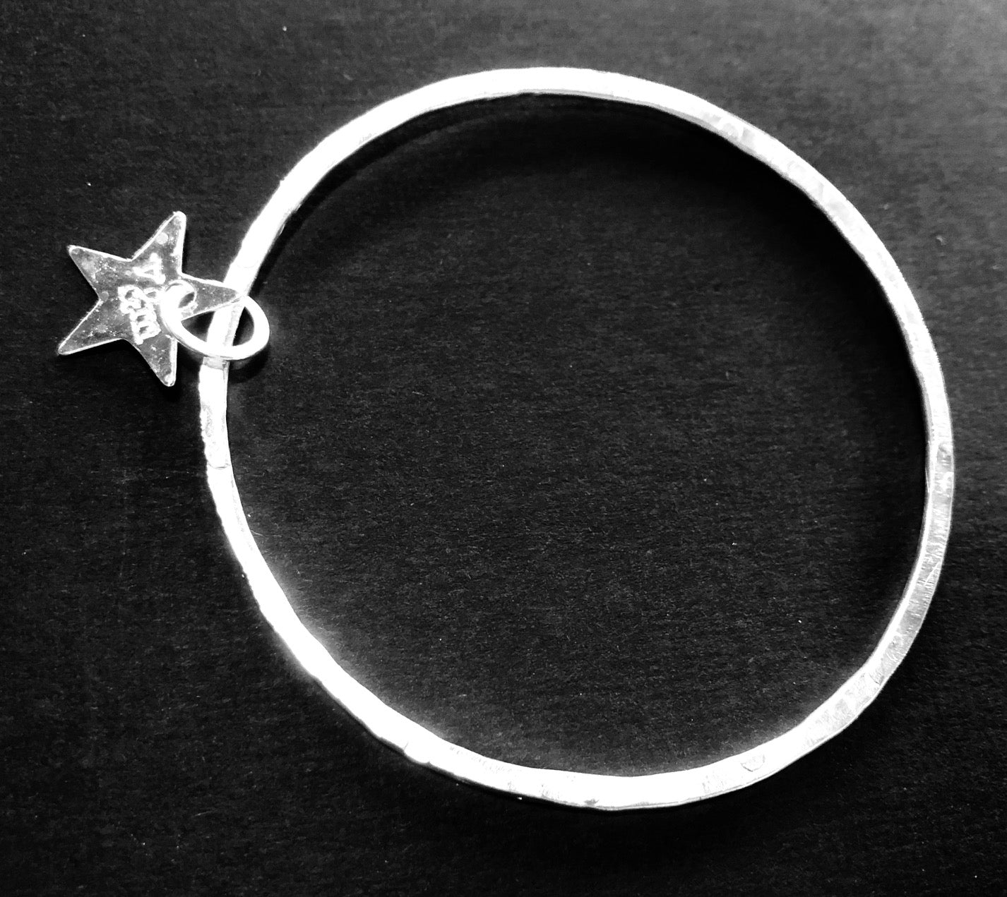 Thin silver bangle with star
