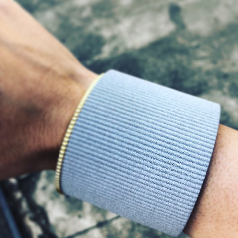 Contrasts: INGRANAGGI Armour Cuff in silver Alumide vs INGRANAGGI Minimal Bangle in 18Kt Gold plated brass by V DESIGN LAB Jewellery