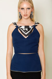 Blue crepe cropped top tied with a signature silk MagnaDi scarf
