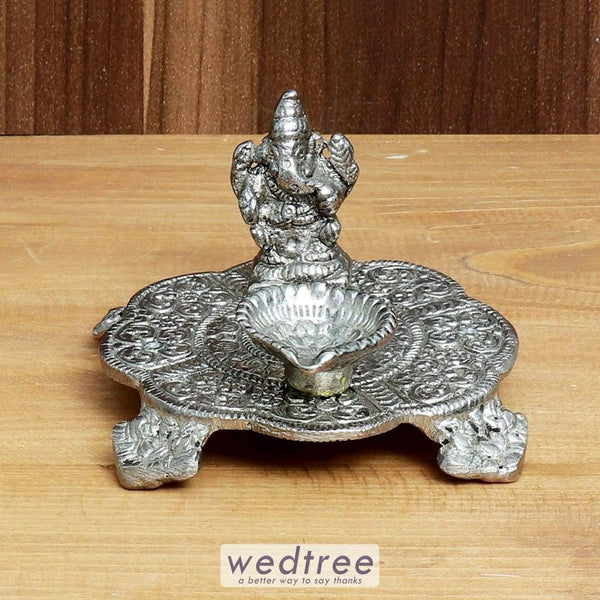 White Metal Ganesh Chowki With Diya Diyas & Candle Holders
