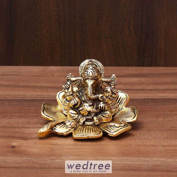 White Metal Ganesha In Flower With Gold Finish - W3571 Divine Return Gifts