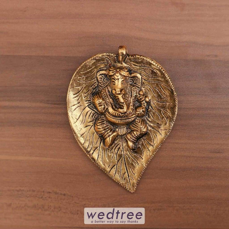 White Metal Ganesha On Leaf Gold Finish - W4001 Divine Return Gifts