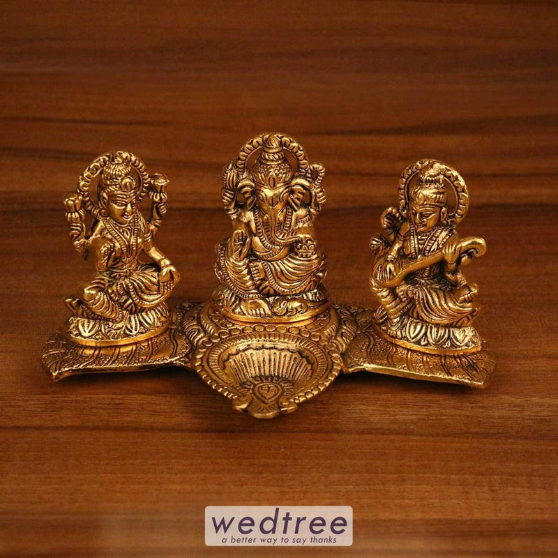 White Metal Gold Lakshmi Ganesha Saraswati With Diya Leaf Base Home Decors