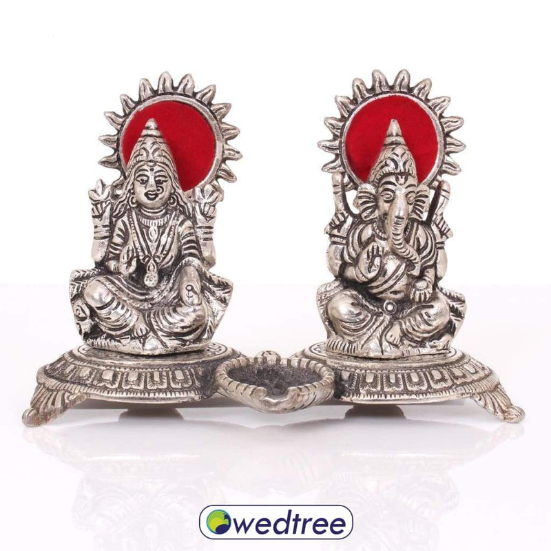 White Metal Lakshmi Ganesh With Diya Diyas & Candle Holders