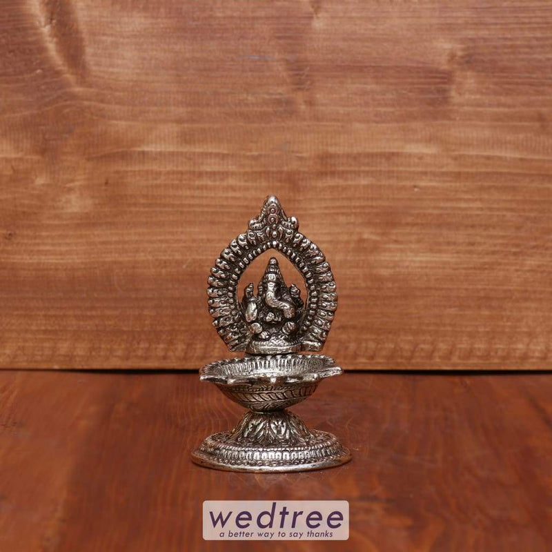White Metal Oxidised Ganesha With Diya Small - W3971 Diyas & Candle Holders