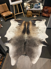 Cow Hide Rug #827 HOLD PHONE ORDER.