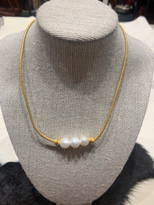 Three Freshwater Pearls on gold coloured leather #315
