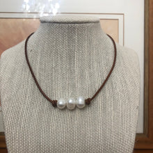 Three Freshwater Pearls on dark tan leather #315
