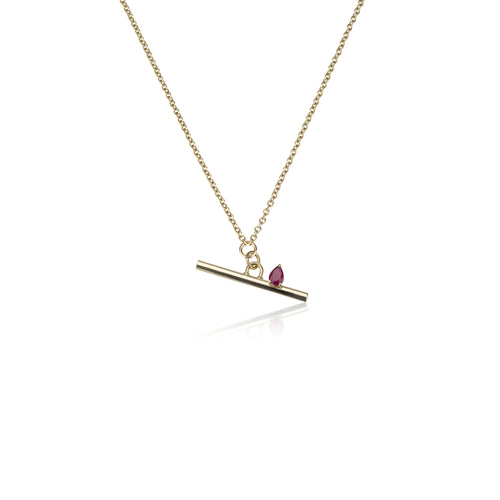 A Gold Line Necklace With A Ruby