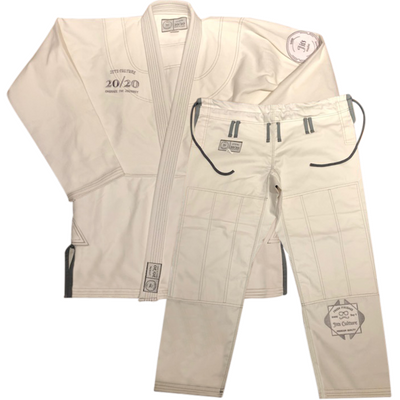 Original bjj Jits Culture gi in white with dark grey contrast stitching and logos.  Comes with a rope drawstring cord, 350 gsm pearl weave top, and cotton twill reinforced pants. A special black pen is included for feeding the drawstring through the pants if needed.