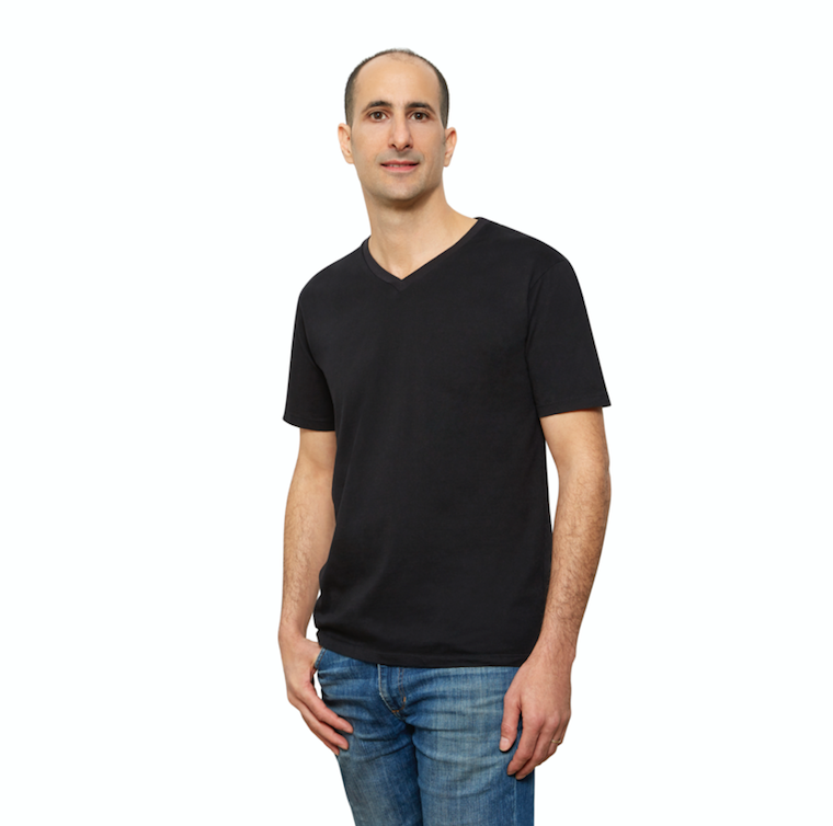 Black Organic Cotton T Shirt for Men, V Neck, Short Sleeve on Model (side view)