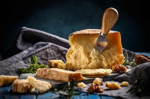 Parmesan cheese with cheese knife