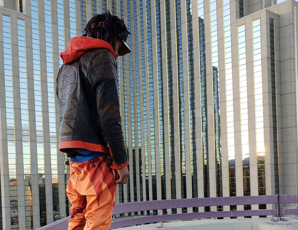 goku dragon ball z leather jacket by luca designs with cityscape