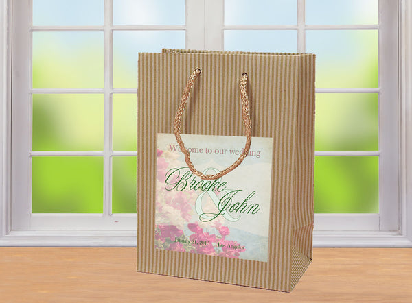 Rustic wedding welcome bag with pink n sage label applied