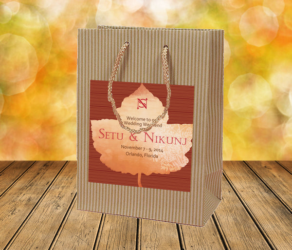rustic fall wedding welcome bag with monogram leaf label applied