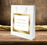 white gloss welcome bag with gold ink frame label applied