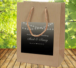 rustic wedding welcome bag with string of lights label applied