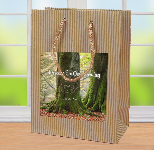 Rustic wedding welcome bag with initials in tree label applied