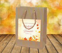 Rustic autumn Kraft wedding welcome bag with fall leaf design