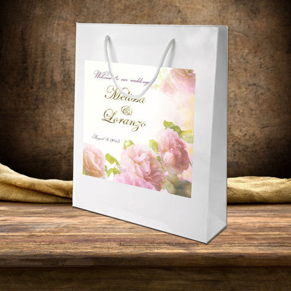 wedding welcome bag | pink roses on white gloss hotel favor bag