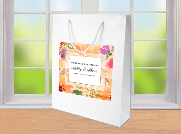 Summer wedding welcome bags | floral hotel guest gift bags