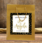 gold wedding welcome bag with custom label applied