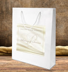gloss wedding welcome bag with gold monogram label applied