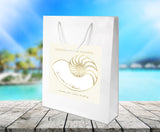 white gloss bag with gold nautilus seashell label applied