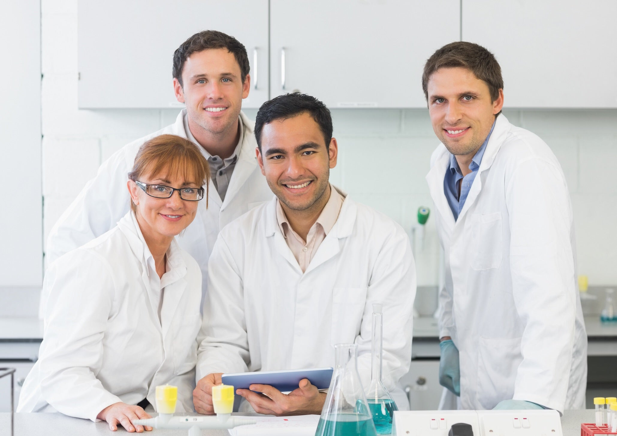 Portrait image of smiling scientists in a laboratory setting