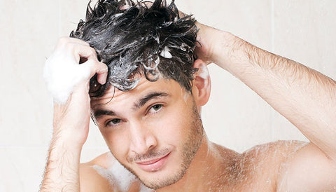 Image of a young man shampooing his hair
