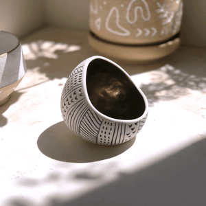 Etchform porcelain vessel in sunlight