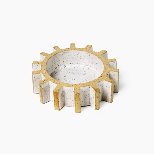 sculptural gear or cog tray on plain background
