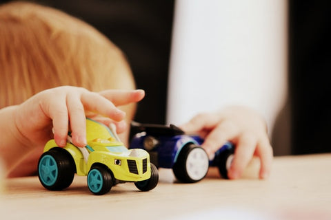 A boy playing with toys
