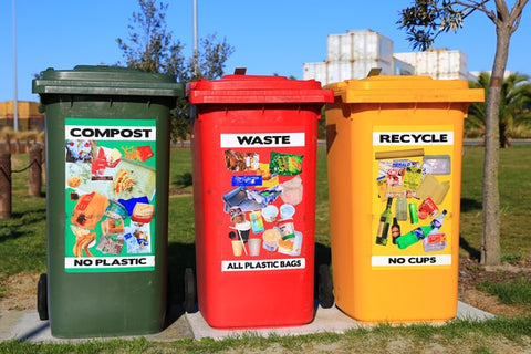 Three trash cans for recycling