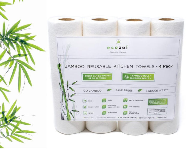 Photo showing a 4-pack of bamboo reusable kitchen towels next to some bamboo leaves