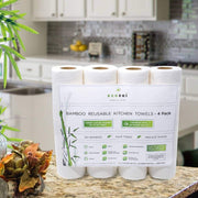 Photo showing a 4-pack of reusable bamboo kitchen towels on a kitchen counter