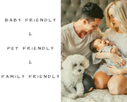 photo showing a family with a mom, dad, baby and a dog